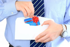 Business man opening direct mail incentive